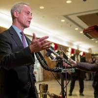 Chicago Mayor Rahm Emanuel speaks with members of the media after meeting with President-elect Donald Trump at Trump Tower in New York Wednesday. | AP