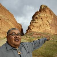 Malcolm Lehi, a Ute Mountain Tribal Commissioner, points to a rock formation in July near Blanding, Utah. 'We don't want to forget about our ancestors,' said Lehi. 'Through them we speak. That's the whole concept of protecting and healing this land. They are still here among us as the wind blows.' President Barack Obama designated two national monuments Wednesday at sites in Utah and Nevada. | AP
