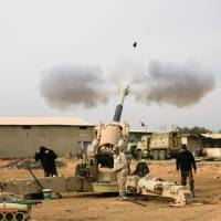 Iraqi army forces fire toward Islamic State militant positions in Mosul from the outskirts of Bartila, Iraq, Thursday.   REUTERS