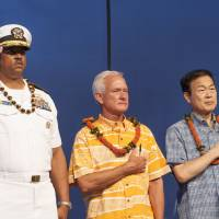 U.S. Navy Rear Adm. John Fuller (left), Honolulu Mayor Kirk Caldwell and then-Nagaoka Mayor Tomio Mori look on during a celebration marking the 70th anniversary of the end of World War II at Joint Base Pearl Harbor-Hickam in Honolulu on Aug. 15, 2015. | AP