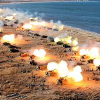 Korean People's Army artillery units take part in a drill in this image released Friday. | REUTERS