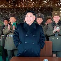 North Korean leader Kim Jong Un attends an drill by Korean People's Army artillery units in this image released Friday. | REUTERS
