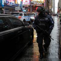 Big Apple boosts security for New Year's after Europe attacks, deploys trash trucks full of sand