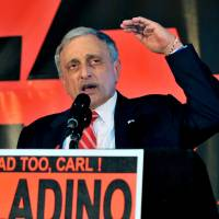 Republican gubernatorial candidate Carl Paladino concedes to a crowd in Buffalo in 2010 as he gestures about 'raising the bar' in Albany. | REUTERS