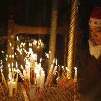 Christmas Eve brings pilgrims to Bethlehem, fears in Europe