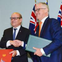 Australia formally inks mega-deal to buy French submarines