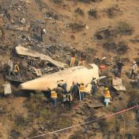 Pakistan mourns 47 killed in air crash as investigators seek answers