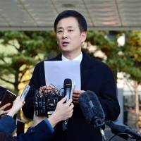 Yoo Yeong-ha speaks during a news conference at the Prosecutor's Office in Seoul on Nov. 15. | REUTERS
