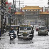 Strength of typhoon weakens but Philippines now braces for floods, mudslides
