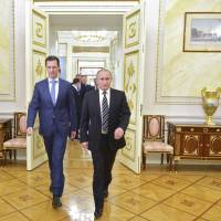 Russian President Vladimir Putin and Syrian President Bashar Assad meet at the Kremlin in Moscow on Oct. 20, 2015. | REUTERS