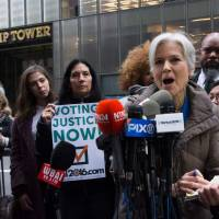 Vote recount focus shifts to Michigan, Pennsylvania as Stein draws hecklers outside Trump Tower