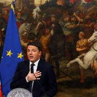 Renzi quits as Italian populists seek quick vote to win power