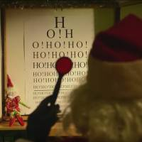 Santa Claus takes a vision test as part of his annual medical examination in this screen shot from a YouTube video by Transport Canada headlined, 'Santa is fit to fly and ready for take-off.'