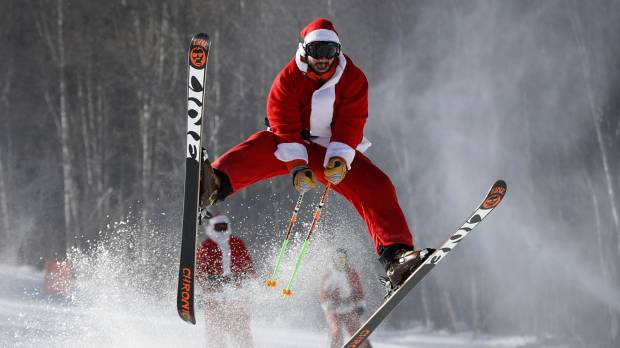 Skiing Santas crowd the slopes in annual Maine charity