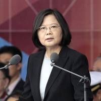 Taiwanese President Tsai Ing-wen delivers a speech during National Day celebrations in front of the Presidential Building in Taipei on Oct. 10. | AP