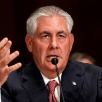 Exxon Mobil CEO and Chairman Rex Tillerson speaks as he and other top oil and gas industry executives testify during a Senate Finance Committee hearing on Capitol Hill in Washington in May 2011. | REUTERS