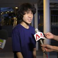 Singapore teen critic held in US, reportedly wants asylum