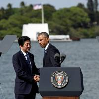U.S. President Barack Obama and Prime Minister Shinzo Abe wrap up their remarks at Kilo Pier overlooking the USS Arizona Memorial at Joint Base Pearl Harbor-Hickam in Honolulu Tuesday. | REUTERS