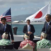 With the WWII battleship USS Missouri in the background, President Barack Obama looks on as Prime Minister Shinzo Abe greets veterans at Kilo Pier overlooking the USS Arizona Memorial on Tuesday. | AFP-JIJI