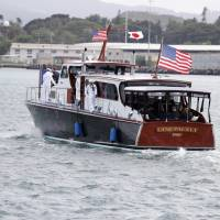 President Barack Obama and Prime Minister Shinzo Abe ride in the stern of the CINCPACFLT (Commander in Chief Pacific Fleet Barge), which is referred to as the Admiral's Barge, to the USS Arizona Memorial, part of the World War II Valor in the Pacific National Monument, in Joint Base Pearl Harbor-Hickam, Hawaii, adjacent to Honolulu Tuesday as part of a ceremony to honor those killed in the Japanese attack on the naval harbor. | AP
