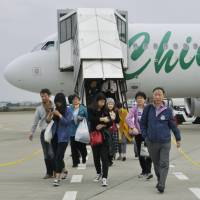 Passengers flying from Shanghai arrive at Ibaraki Airport in November 2015. | KYODO