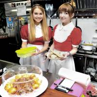 Waitresses dressed as Russian maids serve food at ItaCafe in Tokyo's Waseda district on Nov. 23. | YOSHIAKI MIURA