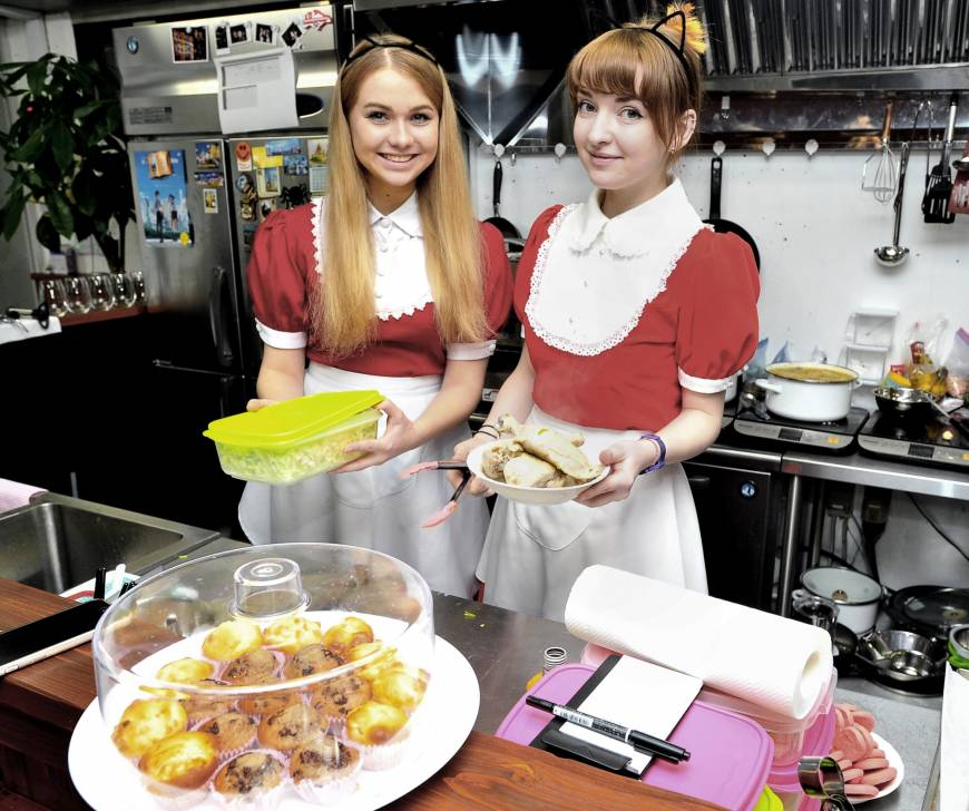 Waitresses dressed as Russian maids serve food at ItaCafe in Tokyo