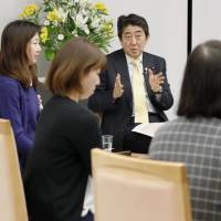 Prime Minister Shinzo Abe meets women with part-time work experience at his office in Tokyo on Dec. 6. | KYODO