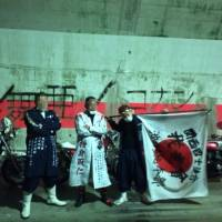 Shotaro Nagasawa and two of his bosozoku friends pose for a photo on the last day of their retirement ride in February 2015. | COURTESY OF SHOTARO NAGASAWA