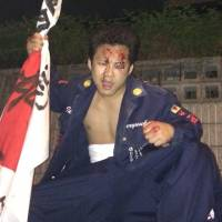 Shotaro Nagasawa poses in triumph in September 2014 after ambushing a gang of bosozoku he was feuding with and successfully beating them up until they, in his words, 'stopped moving.' | COURTESY OF SHOTARO NAGASAWA