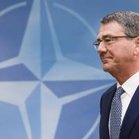 U.S. Defense Secretary Ash Carter arrives for a meeting of the North Atlantic Council Defense Ministers session at NATO headquarters in Brussels in this Oct. 26 file photo. Carter said Monday that the United States is satisfied with Japan's contribution to the alliance between the two countries. | AP