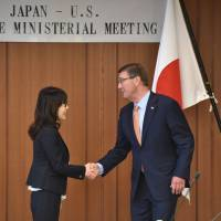 U.S. Defense Secretary Ash Carter is welcomed by Defence Minister Tomomi Inada prior to their talks at the Defence Ministry in Tokyo on Wednesday. | AFP-JIJI