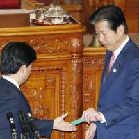 Komeito chief Natsuo Yamaguchi votes against the controversial casino bill during the Upper House plenary session Wednesday. Despite being part of the ruling coalition, Komeito left the decision to each of its members.   KYODO