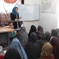 Women in Afghanistan's Herat province attend a literacy class in June. | NIPPON INTERNATIONAL COOPERATION FOR COMMUNITY DEVELOPMENT