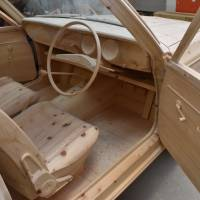 A wooden model of a Toyota Corolla unveiled in Toyota, Aichi Prefecture, on Dec. 8 has a gear shifter, steering wheel and seats that look exactly like the real thing.   CHUNICHI SHIMBUN