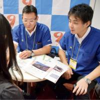 Justice Ministry officials speak to medical students about jobs at correctional facilities in the city of Fukuoka in October. | KYODO