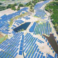Photovoltaic panels stand on what used to be a golf course in Hitachi, Ibaraki Prefecture, in April. | COURTESY OF KOICHIRO OTAKI