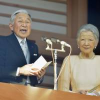 Emperor Akihito offers New Year's greetings to well-wishers visiting the Imperial Palace in Tokyo last Jan. 2. | KYODO