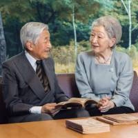 Emperor Akihito speaks with Empress Michiko at the Imperial Palace in Tokyo on Sept. 23. | IMPERIAL HOUSEHOLD AGENCY / VIA KYODO