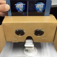 A cardboard virtual reality viewer released by Hacosco Inc. lets people to use their smartphones to experience the technology.   YOSHIAKI MIURA