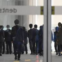 Authorities raid the headquarters of Dentsu Inc. in Tokyo on Nov. 7 on suspicion it forced employees to work illegally long hours. | KYODO