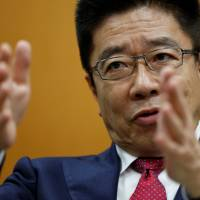 Katsunobu Kato, minister in charge of labor market reform, is interviewed in Tokyo on Dec. 19. | REUTERS