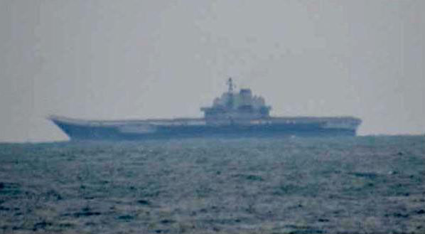 The Maritime Self-Defense Forces spotted the Chinese aircraft carrier Liaonang, accompanied by seven other vessels, in the East China Sea on Saturday. | MINISTRY OF DEFENSE/ VIA KYODO
