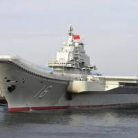 China's first aircraft carrier, the Liaoning, is shown berthed in an unnamed Chinese port in this undated file photo from China's official Xinhua News Agency. | AP