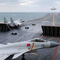 J-15 fighter jets from the Chinese aircraft carrier Liaoning take part in a drill on the Yellow Sea on Friday. The Maritime Self-Defense Force spotted the carrier with five other vessels entering the Western Pacific Ocean for the first time Sunday. | CNS / KYODO