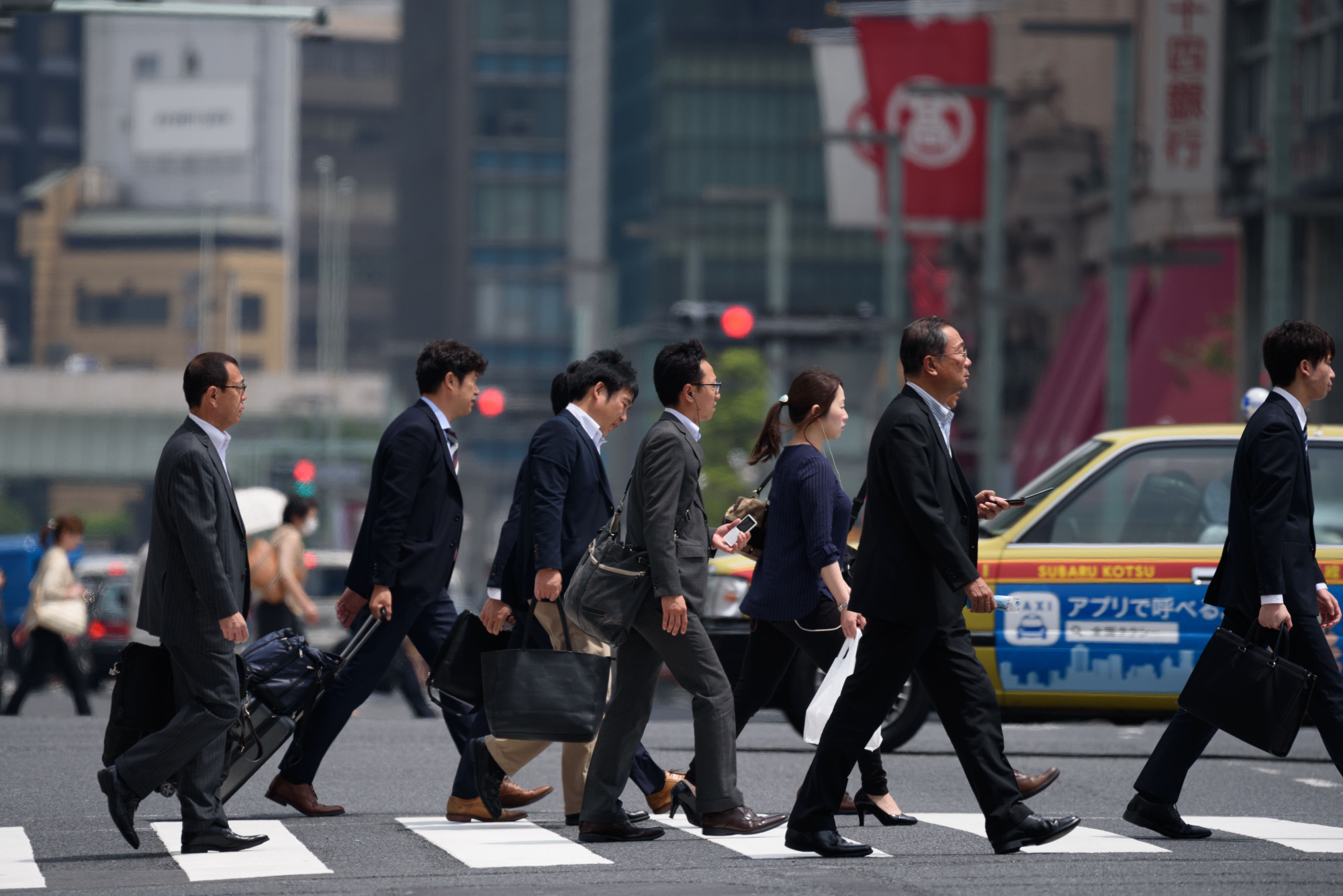 The rigid mindset in Japan that men should be the breadwinners is hitting working men hard today, with many earning barely enough to support their families. | BLOOMBERG