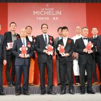 Jiro Ono (front row, second from left), a sushi chef at Sukiyabashi Jiro, and other restaurant owners and chefs given stars on Michelin Guide Tokyo 2017 are awarded at a Tokyo hotel on Tuesday. | KYODO
