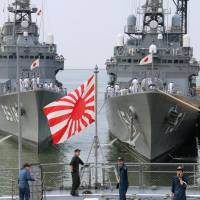 Three Japanese Maritime Self-Defense Force warships — the Setoyuki, left, the Asagiri, right, and the Kashima — arrive at the Port of Manila on a training mission on Oct. 13, 2014. | KYODO
