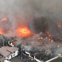 Houses burn in a major fire in Itoigawa, Niigata Prefecture, on Thursday. | KYODO