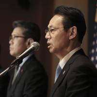 Kenji Kanasugi, Japan's top envoy for dealing with North Korea, speaks at a joint news conference with his South Korean counterpart Kim Hong-kyun (center) and U.S. counterpart Joseph Yun (left) after their talks in Seoul on Tuesday. | AP